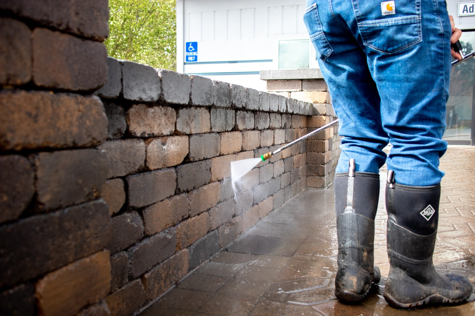 Pressure washing paver wall